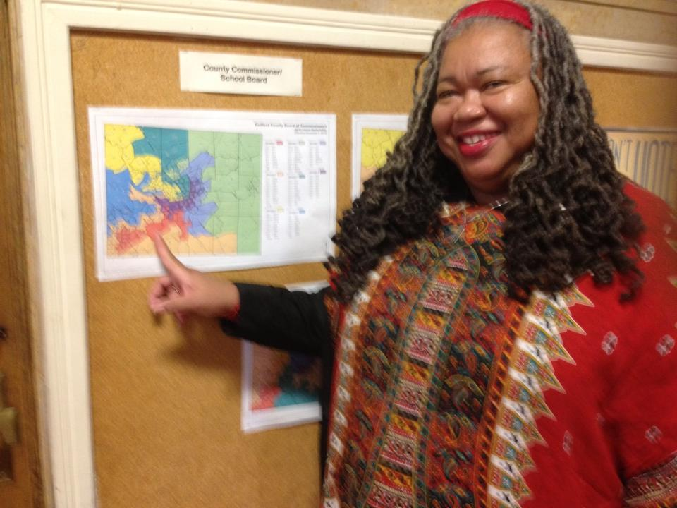 Former Councilwoman Bellamy-Small in front of District Map