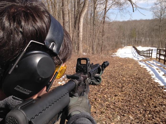 Jon Hardister looking through Optics of AR-15