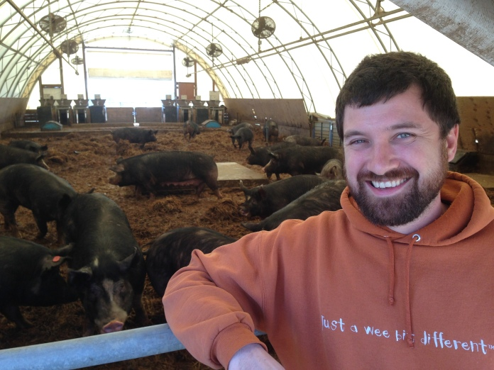 Sam with the Pasture Pigs - talking Spent Grain at NC A&T Farm